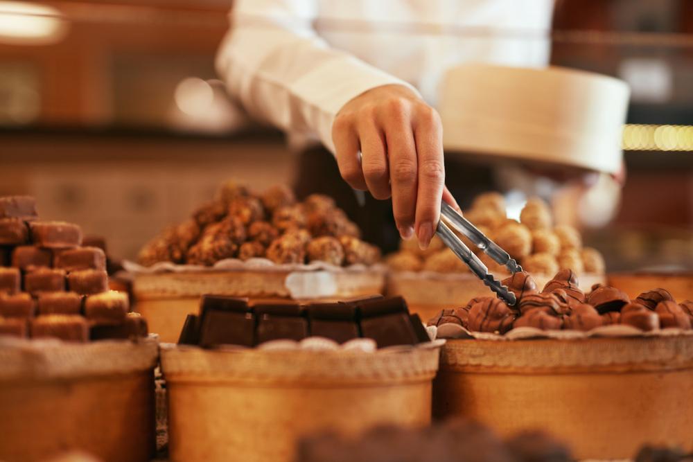 woman buying chocolate